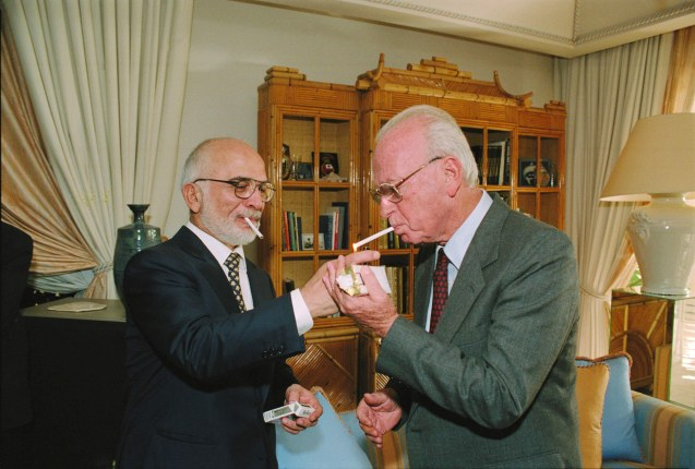 King Hussein lights Yitzhak Rabin's cigarette at the royal residence in Akaba, shortly after the signing the peace treaty, 26 October 1994 @
