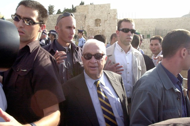 Dozens of people were injured in rioting on the West Bank and in Jerusalem yesterday as the hawkish Likud party leader, Ariel Sharon, staged a provocative visit to a Muslim shrine at the heart of the Israeli-Palestinian conflict. Surrounded by hundreds of Israeli riot police, Mr Sharon and a handful of Likud politicians marched up to the Haram al-Sharif, the site of the gold Dome of the Rock that is the third holiest shrine in Islam. @DR