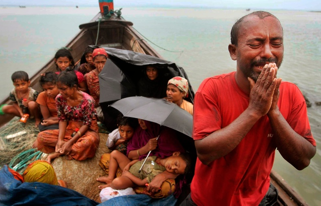 A Rohingya Muslim man who fled Myanmar to Bangladesh to escape religious violence, cries as he pleads from a boat after being intercepted by Bangladesh border authorities in Taknaf, Bangladesh, Wednesday, June 13, 2012. Bangladesh has turned back more than 1,500 refugees in recent days, officials said and a global human rights group on Wednesday urged Bangladesh to keep its border open to people seeking refuge from sectarian violence in western Myanmar. © Anurup Titu | AP