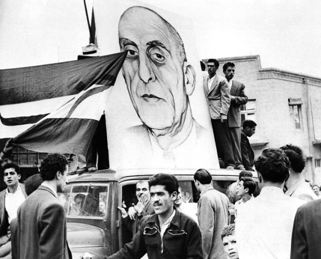 A large drawing of Prime Minister Mossadegh is mounted on top a car during demonstration in Tehran, Iran on Sept. 30, 1951. A large crowd gathered in front of the lower house of Parliament as the opposition joined in solid front against Great Britain's oil complaint to the U.N. @AP Photo) #
