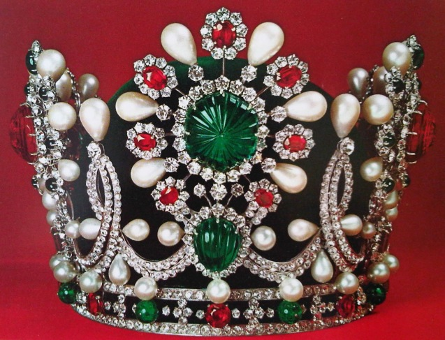 """On the day of her coronation in Teheran, the Empress Farah Pahlavi wore a sumptuous bejeweled crown and emerald necklace created by Van Cleef & Arpels. The Maison also crafted the jewelry sets of the Shah Reza Palhavi's sisters and daughters. This event marked one of the most prestigious special orders in the Maison's history. The crown was adorned with 1541 stones in total, including 1469 diamonds, 36 emeralds, 34 rubies, 2 spinels, 105 pearls among other stones, but most importantly, a spectacular 150-carat emerald set at the center. It weighed 4.3 pounds."" © All Rights Reserved"