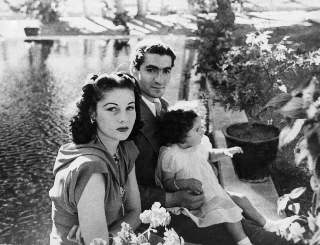 In this undated 1942 file photo, Shah Muhammed Riza Pahlevi, his wife, Queen Fawzia and Princess Shahnaz on the grounds of their palace near Tehran, Iran. @AP Photo, File