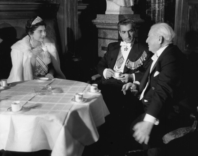 The Shah of Iran and Queen Soraya chat over a cup of Mocca with Adolf Schoenfelder, right, president of Hamburg's citizens, at a reception in Hamburg's city hall, in honour of the royal couple, February 24, 1955. The Shah and his wife arrived yesterday for a four-day stay on their first official visit to West Germany. @AP Photo/Brueggemann)