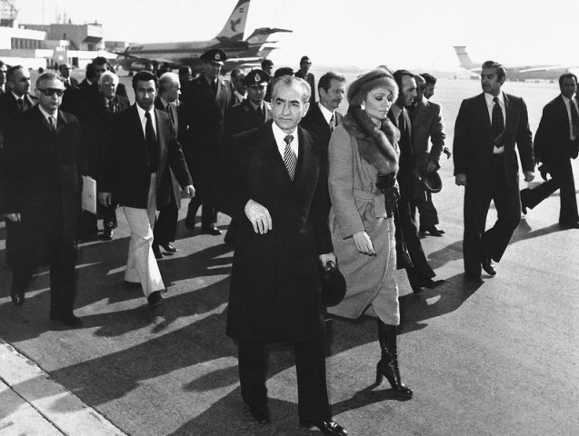 In this Jan. 16, 1979 file picture, Shah Mohammad Reza Pahlavi and Empress Farah walk on the tarmac at Mehrabad Airport in Tehran to board a plane to leave Iran. The popular revolt against the shah raised alarm bells in the West, which saw the shah as a trusted ally and counterweight to hard-line Arab regimes and Palestinian radicals. The face of the revolution was Ayatollah Ruhollah Khomeini, whose demeanor, vehemently anti-American rhetoric and stern interpretation of Islam challenged not only Western interests but also Western values. @AP Photo)