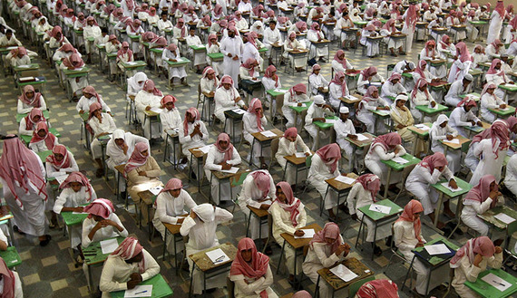 "Two weeks ago, Al-Hayat published a story titled, ""The Ministry of Education prohibits schools from coordinating with lecturers, to protect students intellectually."" The story said that to protect students from any extremist or radical ideologies, the education departments of the Ministry of Education in Saudi Arabia banned schools from coordinating with any preacher to give lectures to students during a school day. According to the story, the Islamic Awareness Administration in the educational department is the body in charge of coordinating between the lecturer and the school and determining the mechanism of the subject to be taught and the timing of the lecture, etc. Read more: http://www.al-monitor.com/pulse/culture/2014/02/saudi-ministry-education-religious-lectures-priorities.html##ixzz2tKGrK9sC school students sit for an exam at the Abu Baker Al Arabi government school in Riyadh June 20, 2010. Saudi students from elementary, middle and high schools across the kingdom have started their one-week long mid-term exams. @REUTERS/Fahad Shadeed (SAUDI ARABIA - Tags: EDUCATION SOCIETY) - RTR2FFNT"