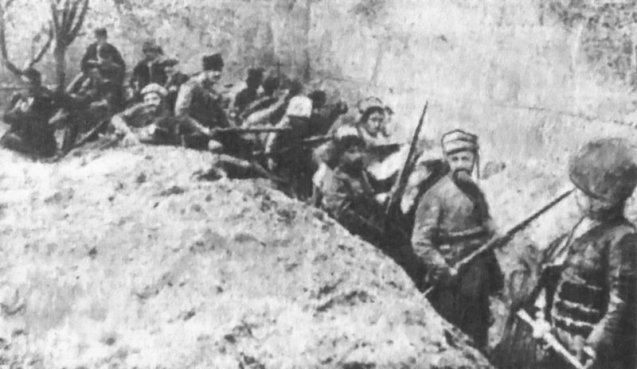 Armed Armenian civilians and self-defense units holding a line against Ottoman forces in the walled Siege of Van in May 1915. @DR