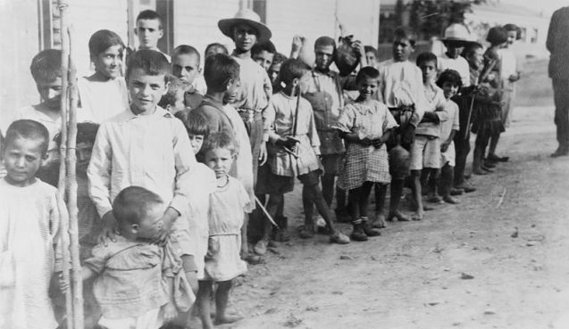 Greek and Armenian refugee children near Athens, Greece, in 1923, following their expulsion from Turkey. @DR