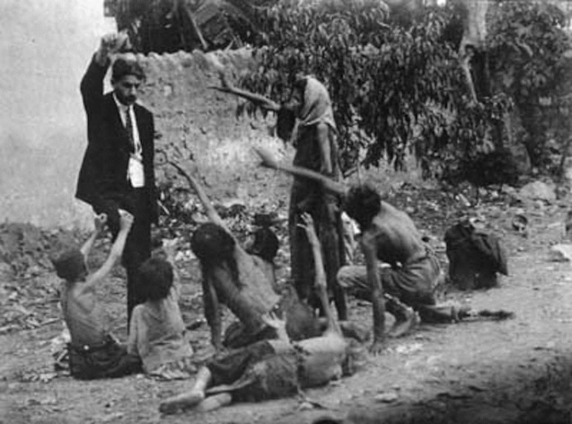 Turkish official teasing starved Armenian children by showing bread, 1915 @DR