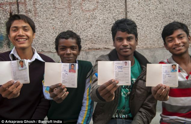 Four members show their pass books - which are needed to make a deposit @Arkaprava Ghosh | Barcroft India | The Daily Mail