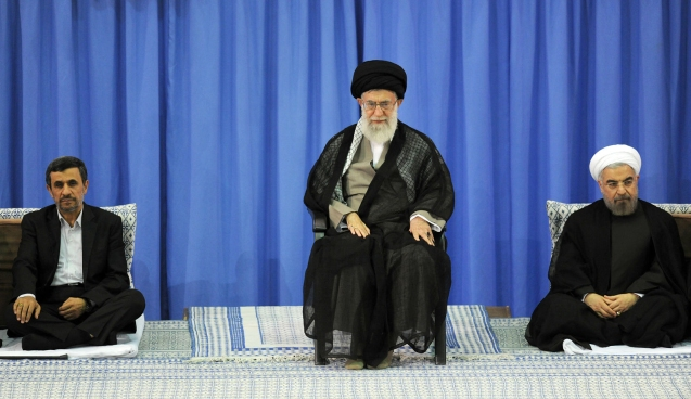 A handout photo made available by Iran's supreme leader website shows Iran's Supreme Leader Ayatollah Ali Khamenei (C), ex-president Mahmoud Ahmadinejad, and New Iranian President Hassan Rowhani sit during a ceremony for Rowhani`s confirmation as Iran's president in Tehran, Iran, 03 August 2013. © EPA/HO
