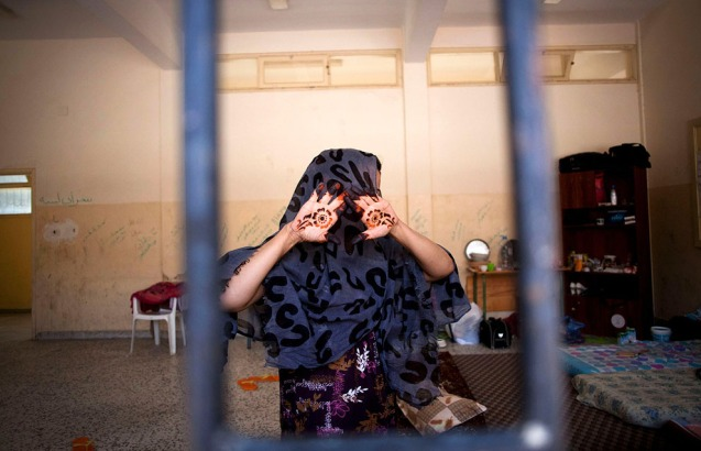 A woman suspected of being a Qaddafi loyalist, behind bars inside a detention facility in Misrata, Libya, on September 22, 2011. Muammar Qaddafi's former prime minister has been arrested in Tunisia, officials said, as Libya's new rulers and NATO warned the fugitive leader and his loyalists that they are running out of places to hide. @AP Photo/ Manu Brabo)