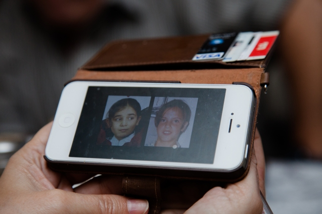 On his mobile telephone, Rami Elhanan, an active member of the Parents Circle Forum Family, shows pictures of his 14-year old daughter (on the right), who was killed by a Palestinian suicide bomber, and of the 10-year old daughter of his Palestinian friend Bassam Aramin, murdered by Israeli border police. @ Udi Goren