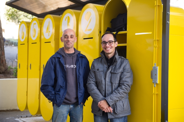 Duarte Paiva (r.) stands with Jorge Toledo in front of the lockers he designed for homeless people in Lisbon to store their treasured possessions. @ Nuno Nunes