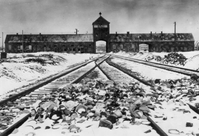 "An undated archive photograph shows Auschwitz II-Birkenau main guard house which prisoners called ""the gate of death"". An undated archive photograph shows Auschwitz II-Birkenau's main guard house which prisoners called ""the gate of death"" and the railway with the remains of abandoned crockery. The railway, which was built in 1944, was the last stop for the trains bringing Jews to the death camp. © REUTERS/HO-AUSCHWITZ MUSEUM"