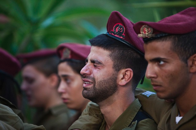 Israeli soldiers mourn during the funeral of their comrade Bnaya Rubel in Holon, near Tel Aviv © Reuters