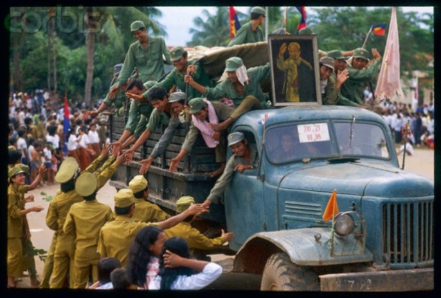 10 years of the Vietnamese occupation of Kampuchea officially ended on 26 September 1989, when the last remaining contingent of Vietnamese troops were pulled out. The departing Vietnamese soldiers received much publicity and fanfare as they moved through Phnom Penh, the capital of Kampuchea. 22 Sep 1989, Pursat, Cambodia --- Departure from Kampuchea of 15,000 men of the Vietnamese occupation army. --- Image by 10 years of the Vietnamese occupation of Kampuchea officially ended on 26 September 1989, when the last remaining contingent of Vietnamese troops were pulled out. The departing Vietnamese soldiers received much publicity and fanfare as they moved through Phnom Penh, the capital of Kampuchea. © Jacques Langevin/Sygma/Corbis