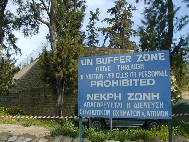 The United Nations Buffer Zone in Cyprus is a demilitarised zone, colloquially known as the Green Line, that runs for more than 180.5 kilometres (112.2 mi) between the two de facto partitions of the island, the Greek Government of Cyprus-controlled area in the south and the Turkish Republic of Northern Cyprus-administered area in the north. ©