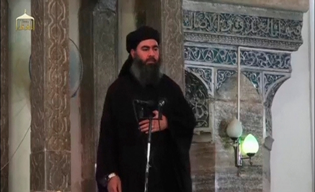 A man purported to be the reclusive leader of the militant Islamic State Abu Bakr al-Baghdadi has made what would be his first public appearance at a mosque in the centre of Iraq's second city, Mosul, according to a video recording posted on the Internet on July 5, 2014, in this still image taken from video. There had previously been reports on social media that Abu Bakr al-Baghdadi would make his first public appearance since his Islamic State in Iraq and the Levant (ISIL) changed its name to the Islamic State and declared him caliph. The Iraqi government denied that the video, which carried Friday's date, was credible. It was also not possible to immediately confirm the authenticity of the recording or the date when it was made. REUTERS/Social Media Website via Reuters TV (IRAQ - Tags: POLITICS) ATTENTION EDITORS - THIS IMAGE HAS BEEN SUPPLIED BY A THIRD PARTY. IT IS DISTRIBUTED, EXACTLY AS RECEIVED BY REUTERS, AS A SERVICE TO CLIENTS. REUTERS IS UNABLE TO INDEPENDENTLY VERIFY THE CONTENT OF THIS VIDEO, WHICH HAS BEEN OBTAINED FROM A SOCIAL MEDIA WEBSITE © Reuters