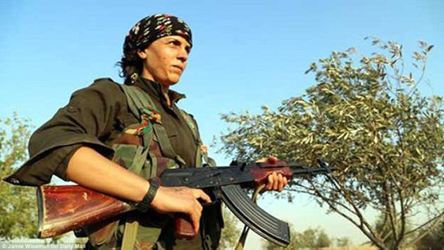 The commander of the Peshmerga forces, dubbed the Peshmerga Princess, defending the besieged Syrian town of Kobane against IS advances is 40-year-old Mayssa Abdo, who uses the nom de guerre Narin Afrin. She has revealed: 'Thousands of civilians are still inside the town. They can't go anywhere – all around us is blocked' Read more: http://www.dailymail.co.uk/news/article-2791469/woman-fighter-leads-battle-against-islamic-state-besieged-syrian-border-town-kobane.html#ixzz3HvAA5MuV Follow us: @MailOnline on Twitter | DailyMail on Facebook © Jamie Wiseman | Daily Mail