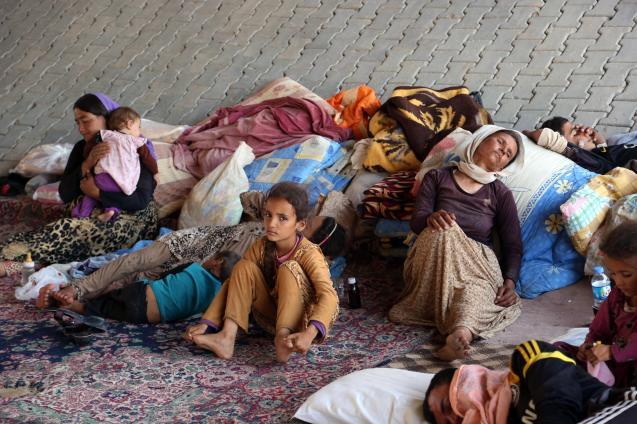 cerca de 700 famílias yaziditas ainda estavam sitiadas no Monte Sinjar, a ocidente da província iraquiana de Mossul, © Khaled Mohamed | Associated Press (AP)