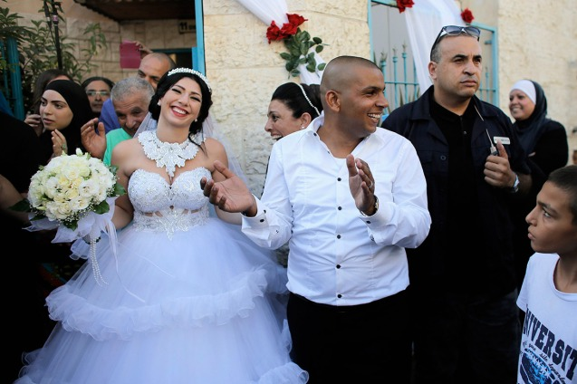 Mahmoud Mansour and Maral Malka celebrate before their wedding in Jaffa, south of Tel Aviv. More than 200 far-right Israeli protesters tried to disrupt the union of a Jewish woman and a Muslim man © Reuters | International Business Times