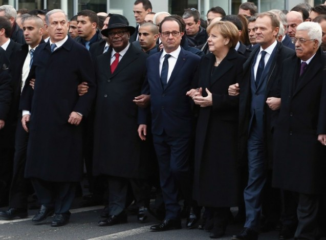 World leaders and dignitaries, including, from left, Israeli Prime Minister Benjamin Netanyahu, Malian President Ibrahim Boubacar Keita, French President François Hollande, German Chancellor Angela Merkel, European Council President Donald Tusk and Palestinian Authority President Mahmoud Abbas, attend a unity rally Sunday in the wake of last week's attacks in Paris. ( © Dan Kitwood/Getty Images)
