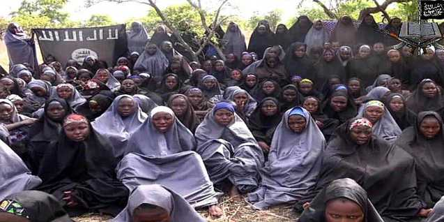 A screen shot of a video released by Boko Haram shows kidnapped Nigerian school girls. Read more: http://www.businessinsider.com/200-nigerian-schoolgirls-could-be-free-by-tuesday-2014-10#ixzz3PhKU50cm © Business Insider