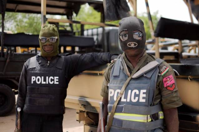 Masked assault: Nigerian police in Borno state prepare for a June patrol in the city of Maiduguri, where the Islamist militant group Boko Haram was founded more than a decade ago | © AFP-JIJI