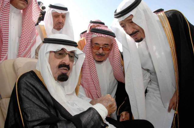 FILE - In this Monday, Nov. 22, 2010 file photo released by the Saudi Press Agency, Saudi Arabia's King Abdullah, left, speaks with Prince Salman, the Saudi King's brother and Riyadh governor, right, before the king's departure to United States, in Riyadh, Saudi Arabia. On early Friday, Jan. 23, 2015, Saudi state TV reported King Abdullah died at the age of 90. ( © Saudi Press Agency, File)
