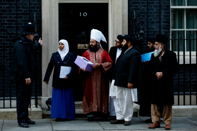 "A petition is delivered to 10 Downing Street by Mrs Amarah Hannan (2nd L) and Peer Munawwar Hussain Shah (3rd L) during a protest near Downing Street in central London on February 8, 2015. Hundreds of demonstrators denounced the depictions of the Prophet Muhammad printed in the French satirical magazine Charlie Hebdo, on a day when, in an interview to be broadcast Sunday, Britain's Prince Charles said the numbers of vulnerable young Muslims being radicalised by ""crazy stuff"" on the Internet was ""frightening"". © AFP"