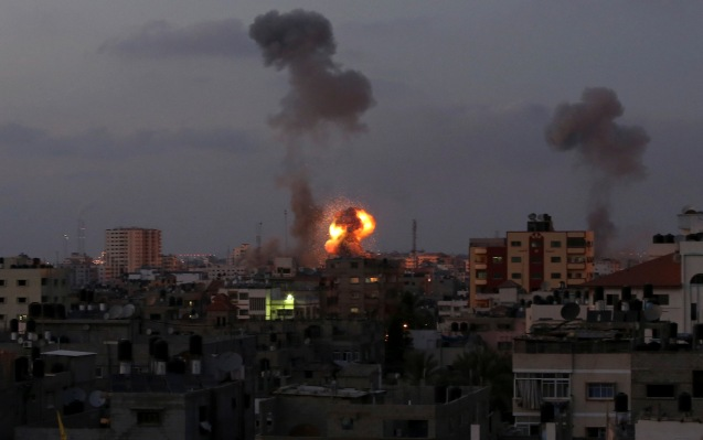 Smoke and a ball of fire rise after an Israeli missile strike in Beit Lahia, northern Gaza Strip, on July 8. © AP