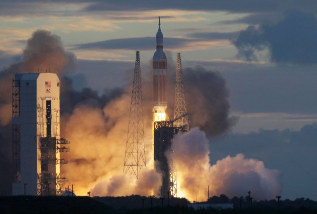 A NASA Orion capsule on top of a Delta IV rocket lifts off on its first unmanned orbital test flight from Complex 37 B at the Cape Canaveral Air Force Station, Friday, Dec. 5, 2014 at Cape Canaveral, Fla. © Marta Lavandier | AP