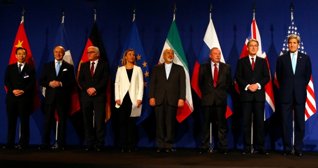 Chinese ambassador Wu Hailong, French Foreign Secretary Laurent Fabius, German Foreign Minister Frank-Walter Steinmeier, EU foreign policy chief Federica Mogherini, Iran's Foreign Minister Javad Zarif, Alexey Karpov, the deputy director of the department for nonproliferation and arms control of the Ministry of Foreign Affairs of Russia, British Foreign Secretary Philip Hammond and U.S. Secretary of State John Kerry (R-L) pose in Lausanne April 2, 2015. Iran and world powers reached a framework on curbing Iran's nuclear programme at marathon talks in Switzerland on Thursday that will allow further negotiations towards a final agreement. © Ruben Sprich |RTR4VXAH | Reuters