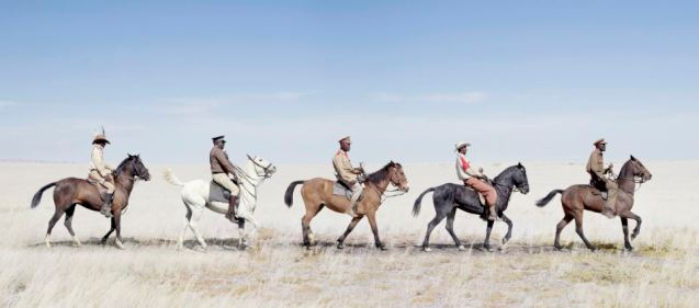 Military uniform: Herero cavalry pictured marching in line in the desert © Jim Naughten | The Daily Mail