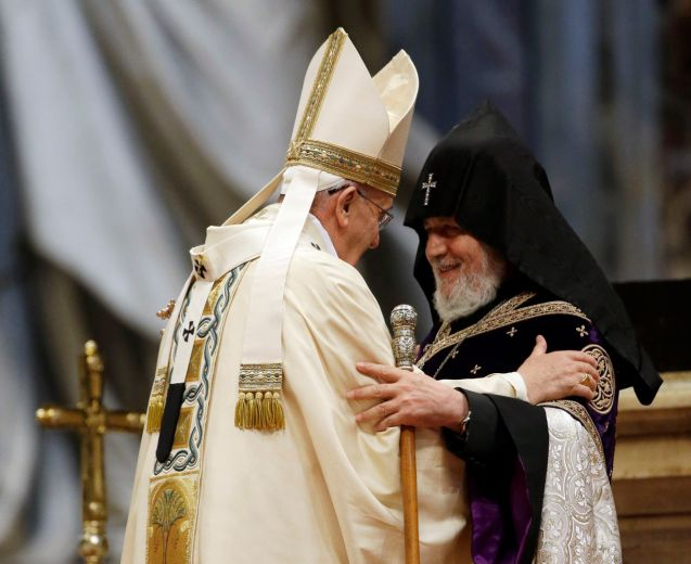 Pope Francis, left, is greeted by the head of Armenia's Orthodox Church Karekin II, during an Armenian-Rite Mass on the occasion of the commemoration of the 100th anniversary of the Armenian Genocide, in St. Peter's Basilica, at the Vatican, Sunday, April 12, 2015. Historians estimate that up to 1.5 million Armenians were killed by Ottoman Turks around the time of World War I, an event widely viewed by genocide scholars as the first genocide of the 20th century. Turkey however denies that the deaths constituted genocide, saying the toll has been inflated, and that those killed were victims of civil war and unrest. © Gregorio Borgia)