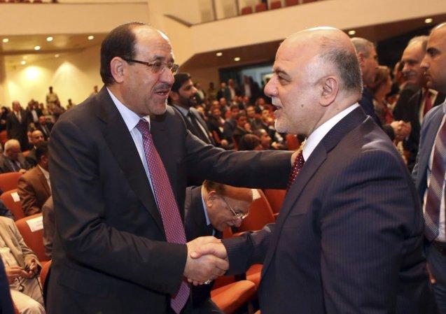 """Um dos maiores obstáculos à solução do conflito no Iraque é uma alegada conspiração do ex-primeiro-ministro Nouri al-Maliki (à esquerda) para derrubar num """"golpe silencioso"""". o actual chefe de Governo, Haider al-Abadi. © cross-head4.rssing.com/"""