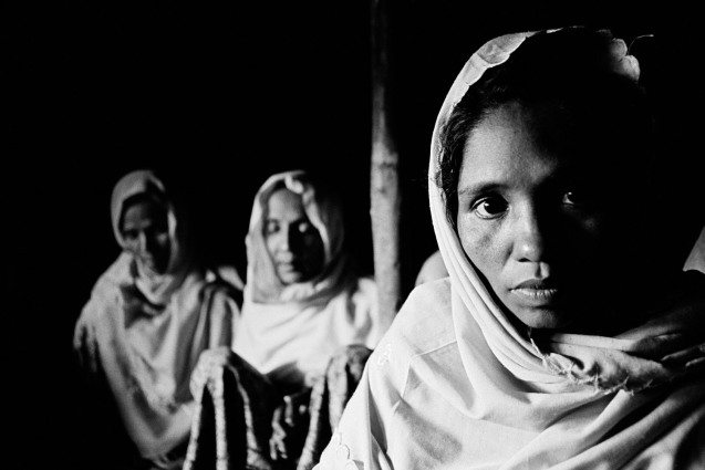 Myanmar (Burma): Recognized as one of the most oppressed groups in the world, the Rohingya are a Muslim minority from western Burma. In 1981 the entire population of Rohingya in the North Rakhine State of Burma (nearly 1 million people) were stripped of their nationality by the Burmese government and have since been stateless. Beatings, extortion and the seizure of their homes in Burma forced these women and 100 families from their village to flee Burma in early 2009. © pulitzercenter.org/