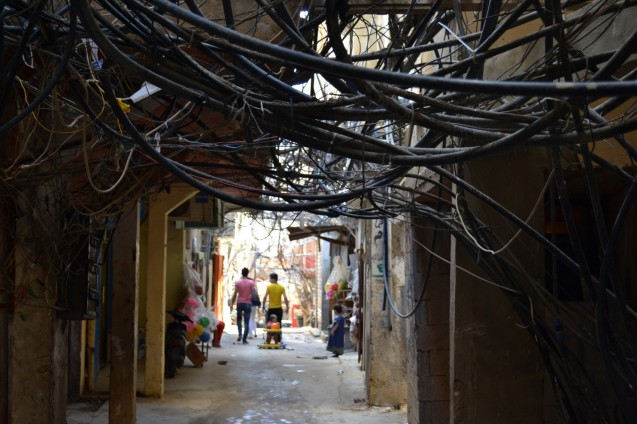 An alleyway in the Bourj al-Barajneh Palestinian refugee camp in Beirut, Lebanon where jumbled electricity and water cables run over cramped streets. © Caroline Anning | The Washington Post