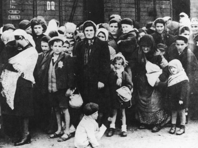 Jewish women and children from Carpatho-Ruthenia after their arrival at the Auschwitz death camp. May/June 1944. © All Rights Reserved