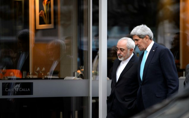 FILE - In this file photo taken Wednesday, Jan. 14, 2015, U.S. Secretary of State John Kerry, right, speaks with Iranian Foreign Minister Mohammad Javad Zarif as they walk in Geneva, Switzerland, ahead of the next round of nuclear discussion. Zarif has borne the brunt of the hard-liners' most recent criticism, particularly over a walk he took with Kerry during negotiations in Geneva in January 2015. © Keystone, Martial Trezzini |AP