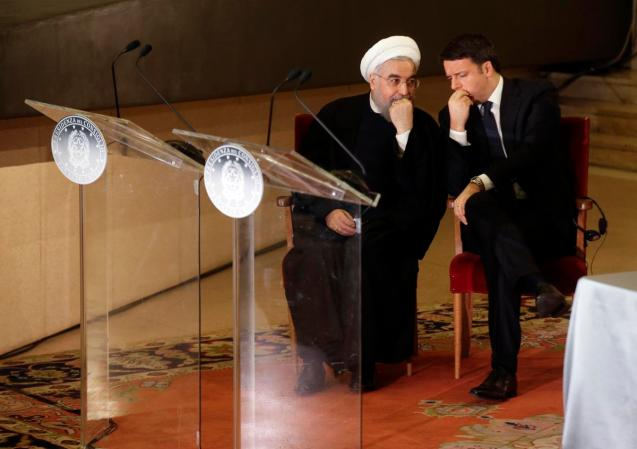 Iranian President Hassan Rouhani, left, and Italian Premier Matteo Renzi talk to eachother ahead of their joint press conference following their meeting at the Campidoglio, Capitol Hill, in Rome, Monday, Jan. 25, 2016. Rouhani arrived Monday in Rome on the first state visit to Europe by an Iranian president in almost two decades, eager for foreign investments after the lifting of international sanctions. © Gregorio Borgia | AP