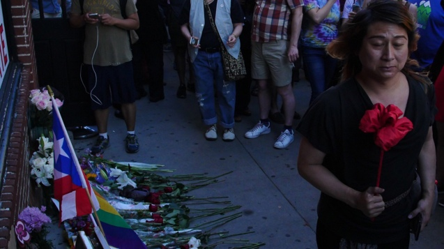 Mourners at New York's Iconic Stonewall Inn Remember LGBT Victims of the Orlando Shooting © http://www.motherjones.com/