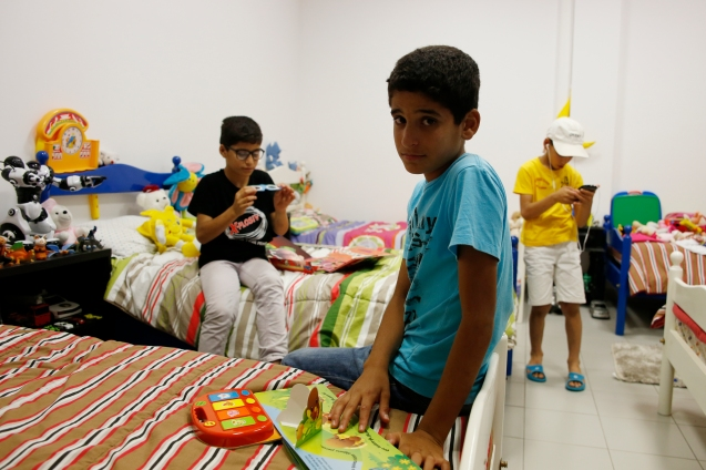 Three of the seven children of the Darwish family playing in their room in the community center: the people of Nazareth were very generous in their donations © Marisol González
