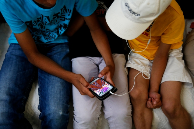 The mobile phone helps the family to communicate with relatives back in Syria but also to listen to the adhaan, the call to the five daily Muslim prayers © Marisol González